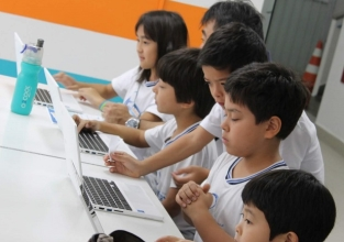 Scratch Day do Pio une pais e filhos em oficinas de programação